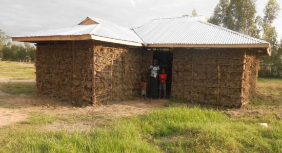 Eunice and her Family with their new house